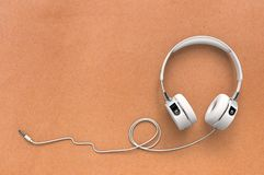 Headphone on paper background Royalty Free Stock Photos