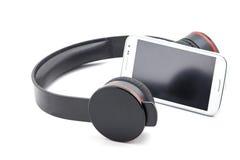Headphone and smartphone. Stock Photo