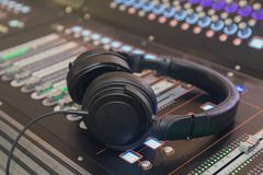Headphone and sound mixer close up. Music royalty free stock photography