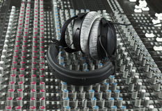 Headphone on a studio mixer Stock Photography
