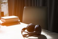 Headphone on table with sunlight feel relaxing. Headphone on table with sunlight Stock Image