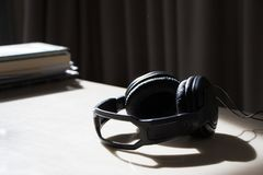 Headphone on table with sunlight feel relaxing. Headphone on table with sunlight Stock Images