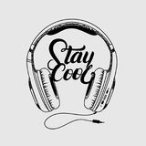 Headphone tee print. Stay cool hand written lettering. Isolated on gray background. Vector illustration stock illustration