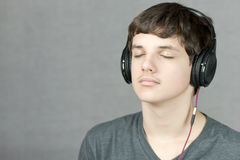 Headphone Wearing Teen Meditates Royalty Free Stock Image
