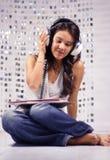 Headphone woman Stock Images