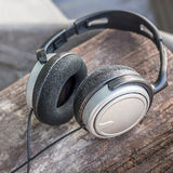 Headphone on Wooden Stock Image