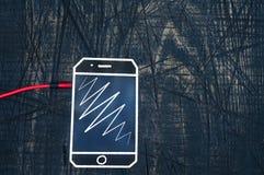 Headphonekabel med telefonen som är horisontal Arkivbilder