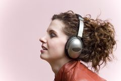 headphonekvinna royaltyfri foto