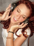 Headphones. Listen to the music Royalty Free Stock Photo