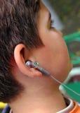 Headphones. Teenager with headphones Stock Photos