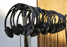 Headphones. In a row on a rack stock photography