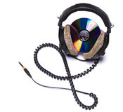 Headphones. Isolated headphones with CD disc Royalty Free Stock Images