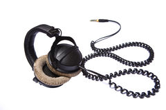 Headphones. Isolated headphones with twirled cable Royalty Free Stock Photo