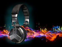 Headphones. And sound-waves on black Royalty Free Stock Photography