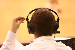 Headphones. Image of a sportscaster wearing audio headphones Royalty Free Stock Photos