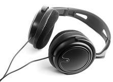 Headphones. Black headphones on white background Royalty Free Stock Photography