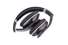Headphones. Folded headphones  isolated on wite Royalty Free Stock Image