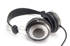 Headphones. Multimedia black and silver headphones over white background Stock Image