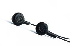 Headphones. A pair of small headphones stock photography