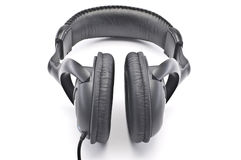 Headphones. Black headphones on a white background Royalty Free Stock Photography