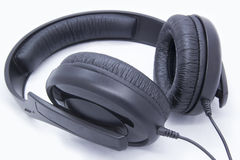 Headphones. Black headphones on white background Royalty Free Stock Images