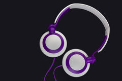 Headphones. White and purple headphones on black background Stock Image