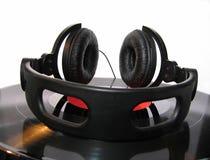 Headphones. Headphones on disk royalty free stock photos