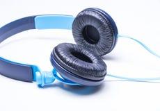 Headphones. Blue headphones isolated on a white background Stock Image