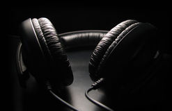 Headphones. Black stereo headphones royalty free stock photography