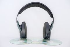 Headphones. Black Headphones And Compact Disc Stock Photo