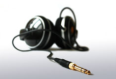 Headphones. With a golden plug in front Stock Images