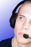 Headphones. Male listening to music throe his headphones Stock Photography