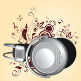 Headphones On Abstract. Silver stereo headphones on an abstract illustration in red, all on an ivory background Stock Photos