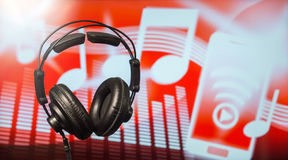 Headphones on abstract background Stock Photos