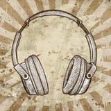 Headphones against grunge background Royalty Free Stock Photos