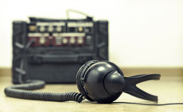 Headphones and amplifier Royalty Free Stock Photography