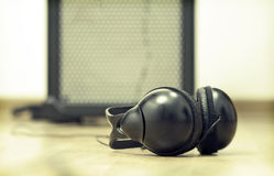 Headphones and amplifier Royalty Free Stock Images