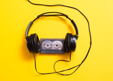 Headphones with audio cassette Royalty Free Stock Photography