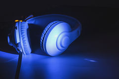 Headphones with audio mixer. Photo Cool tones.  stock photos