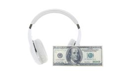 Headphones and banknote Stock Images