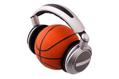 Headphones on a basketball ball Royalty Free Stock Image