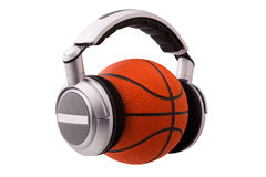 Headphones on a basketball ball Royalty Free Stock Photos