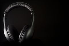 Headphones on a black Stock Image