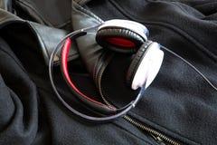 Headphones on a black Jacket Stock Photos