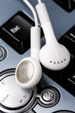 Headphones and black keyboard Stock Images