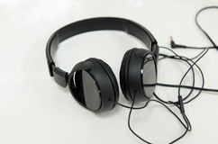 Headphones black on a white background. Headset black on the  white background Royalty Free Stock Photography