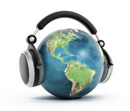 Headphones on blue globe Royalty Free Stock Photography