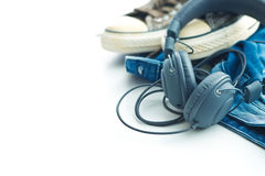 Headphones and blue jeans. Stock Images