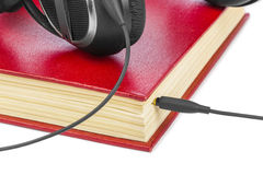 Headphones and book Stock Photography