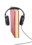 Headphones and book Royalty Free Stock Photo